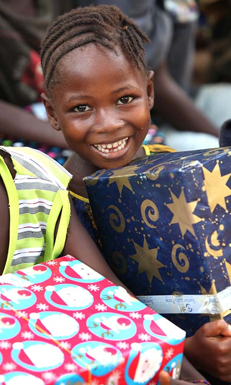 Smiling child with shoebox covered in stars