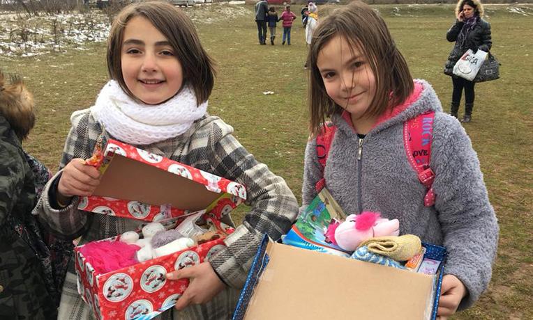Teenage girls with shoebox gifts