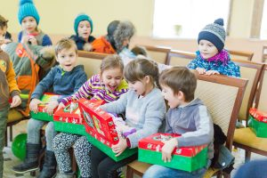 Children exploring shoebox gifts