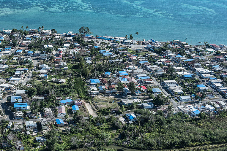 As another hurricane season nears, homes across Puerto Rico still bear the blue roofing tarp that Samaritan's Purse installed following Hurricane Maria.