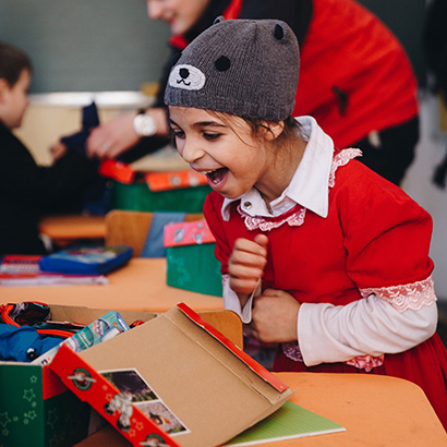 Child excited by shoebox