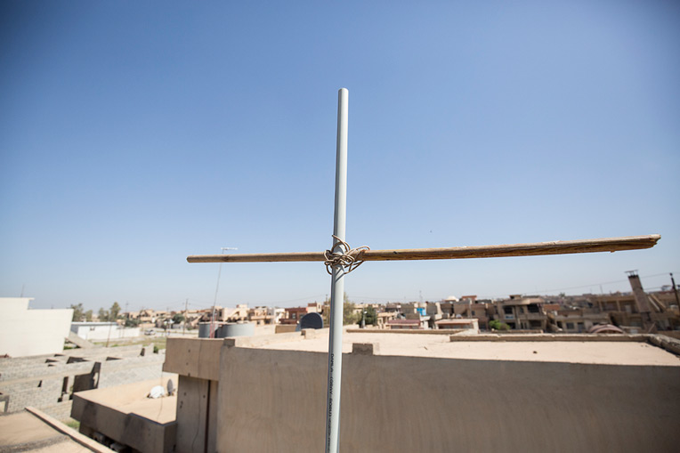Nabil and his family erected a Cross on top of their home to display their devotion to Jesus Christ.
