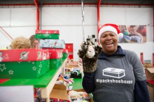 Volunteer checking shoebox gift