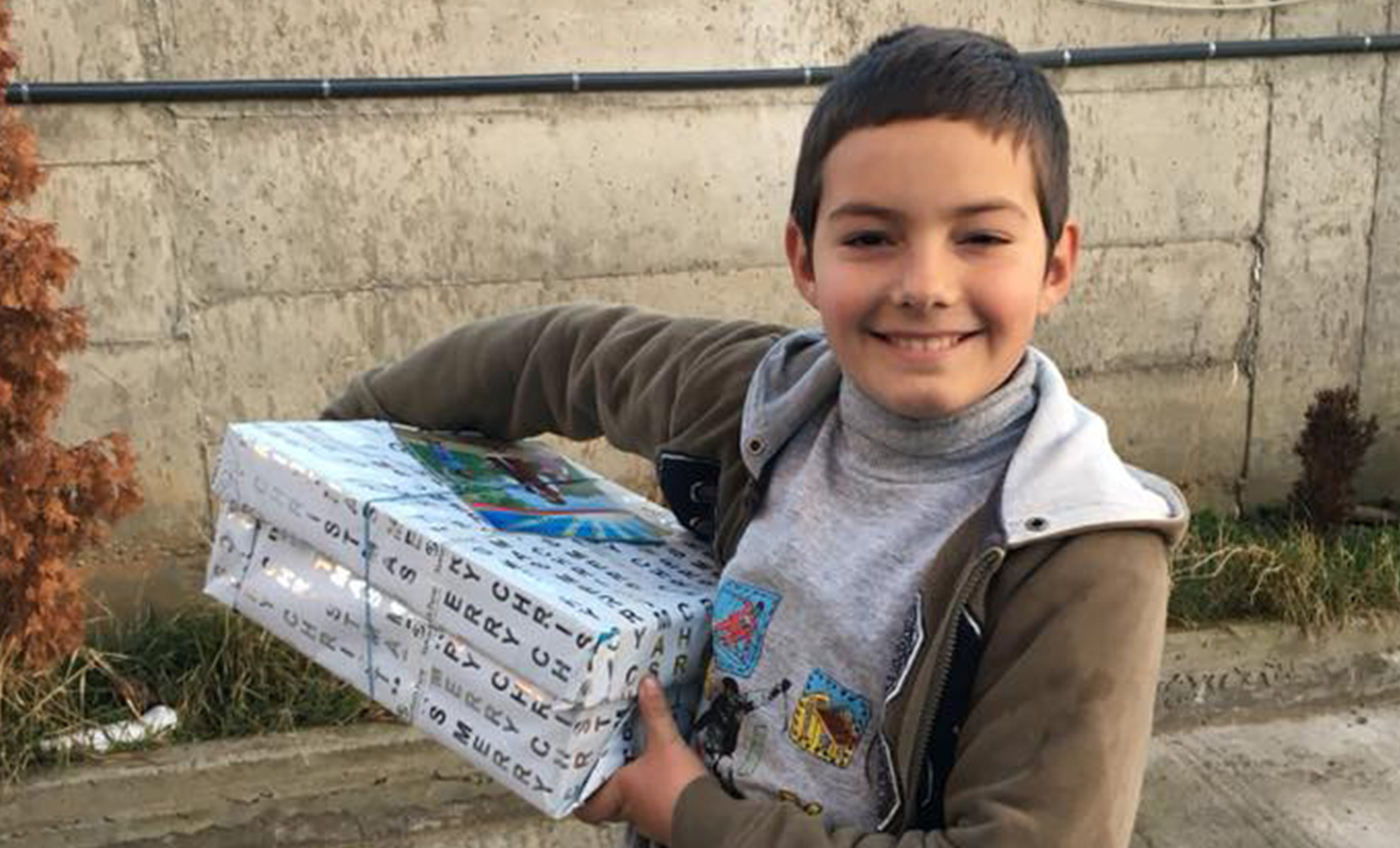 Boy smiles with shoebox gift
