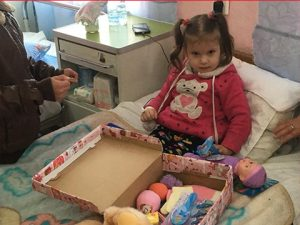 Young girl with shoebox gift