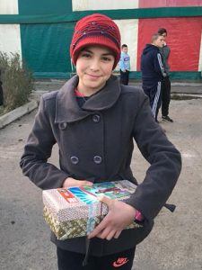 Teenage girl holding shoebox gift
