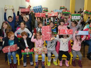 Group of children with shoebox gifts in Bosnia