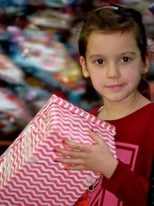 Girl with red and white stripey shoebox