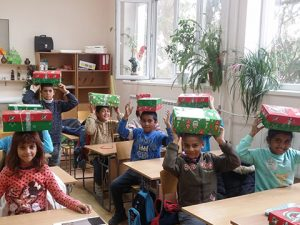 Classroom of children with shoebox gifts