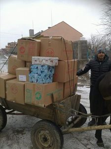 Horse and cart transporting shoebox gifts