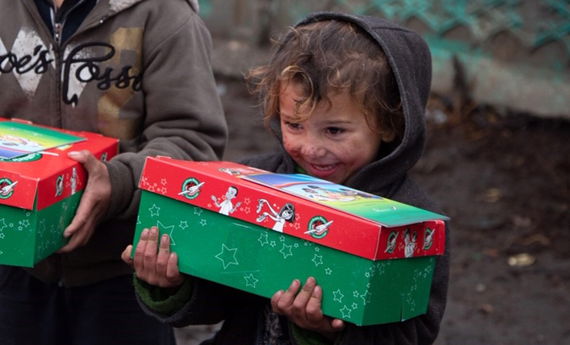 Header image - Young boy holding shoebox gift