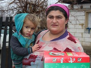 Mother and child with shoebox gift