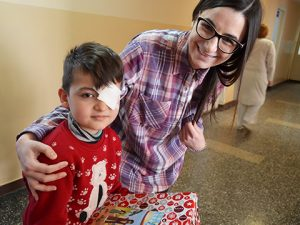 Boy with eyepatch and shoebox gift