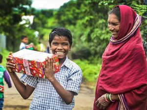 Boy with shoebox gift