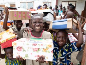 Children with shoebox gifts