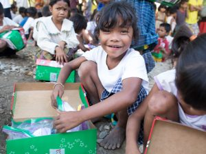 Girl exploring shoebox gift