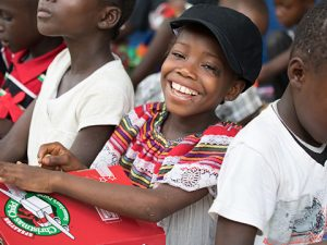 Girl smiling with shoebox