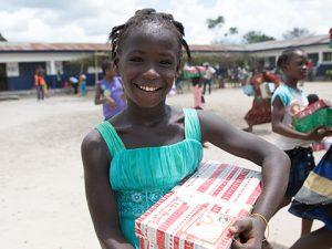 Girl holding stripy shoebox