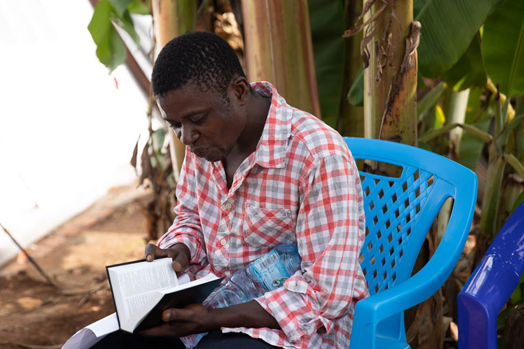 We gave Kavoro, a new Christian, a Bible in Swahili before he left the Treatment Centre.