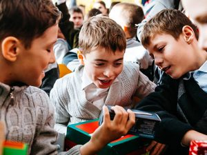 Excited boys explore gift