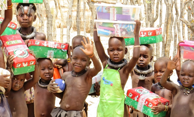 Himba Children receiving shoebox gifts