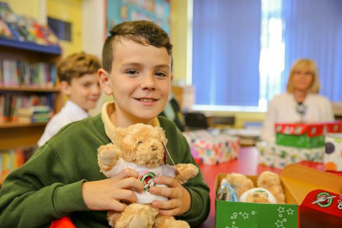 Matthew holding an OCC teddy