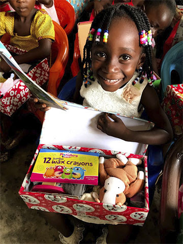 Girl with shoebox gift