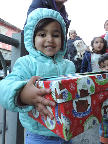 Girl holding shoebox gift