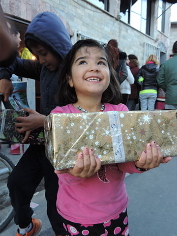 Girl beams with shoebox gift