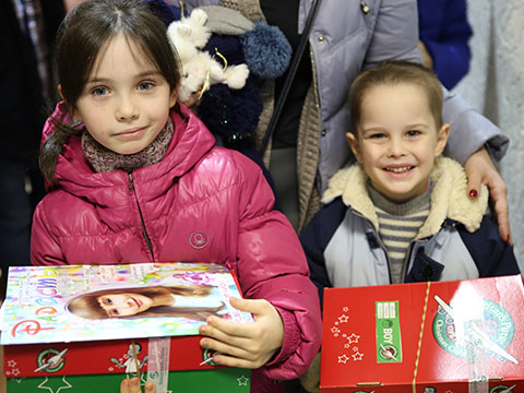 Boy and girl with shoebox gifts