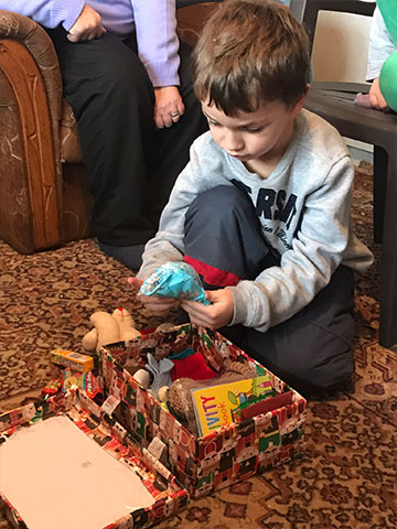 Boy explores shoebox gift