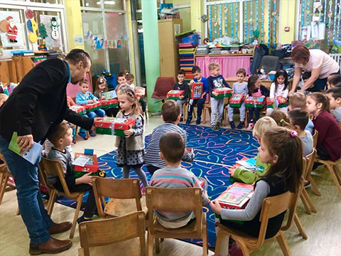 Kindergarten class receiving shoebox gifts