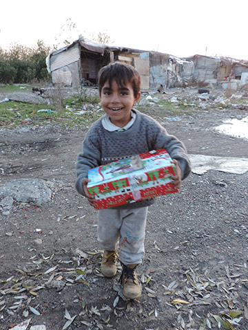 boy holds shoebox gift