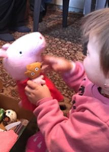 child plays with peppa pig