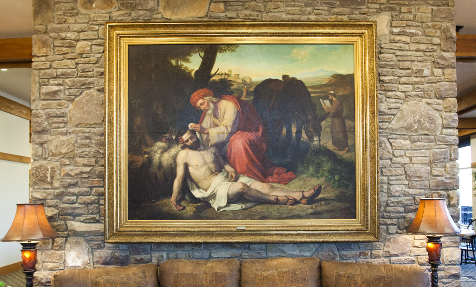 """""""La Caridad del Samaritano"""" literally translated, """"The Charity of the Samaritan"""" is an oil painting by Spaniard Jose Tapiro y Baro (1863-1913) depicting the story of the Good Samaritan from Luke 10:30-37. A gift to Samaritan's Purse in 2011 from the Gamboa Family Trust, the work of art is a reminder to all of Christ's followers to """"Go and do likewise."""" This painting hangs at the entrance to the Furman Building at the ministry's international headquarters in Boone."""