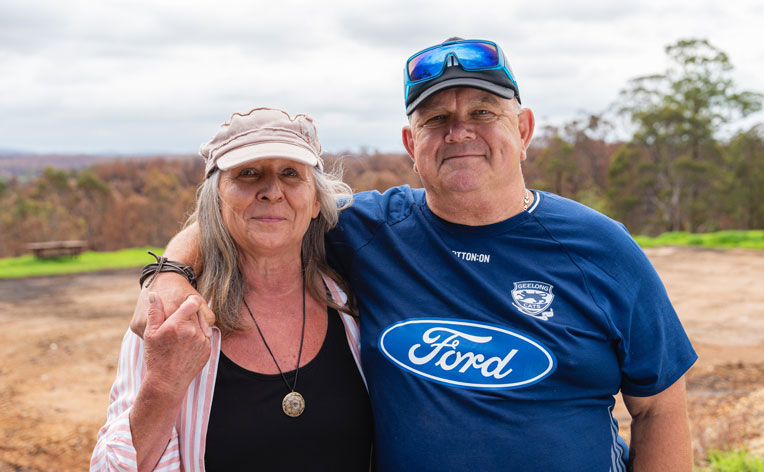 Terry Maki and his partner Patricia experienced God's love through the many volunteers who helped them sift through the ashes of their home.