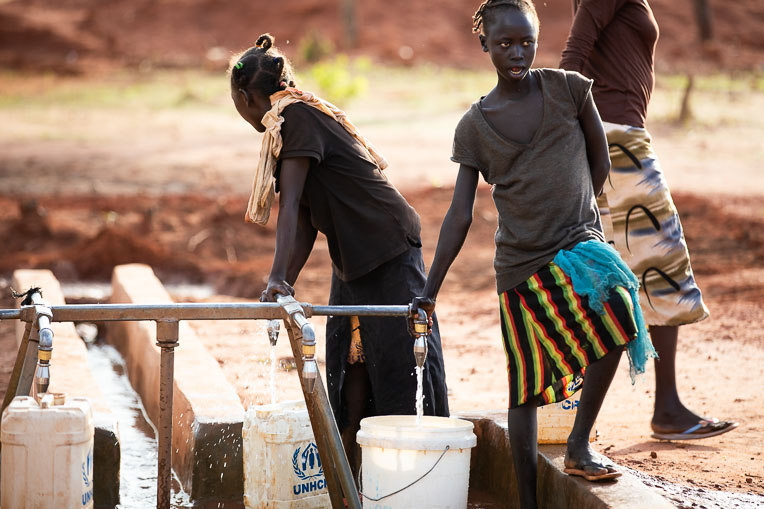 At a point provided by Samaritan's Purse, people in South Sudan gather water for their daily needs.