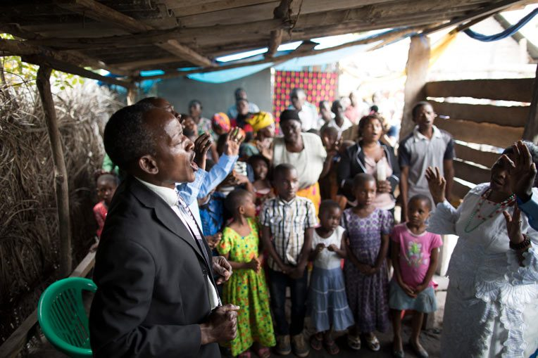 PASTOR MARCO KAYUMBO CELEBRATES WITH CHURCH MEMBERS ALL THAT GOD IS DOING THROUGH MARANATHA CHURCH KITOMONDO.