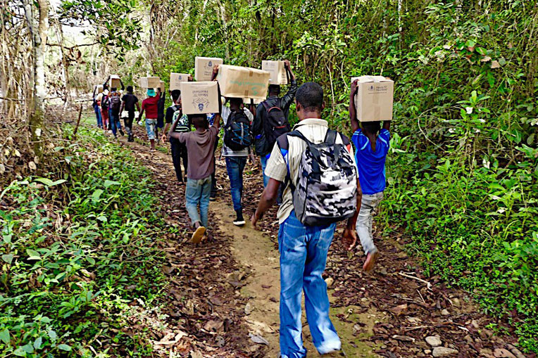 FIFTY UNIVERSITY STUDENTS VOLUNTEERED TO CARRY SHOEBOX GIFTS THROUGH THE JUNGLE TO THE CHILDREN OF BOLO.