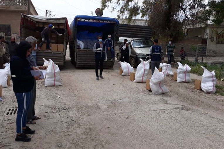 Samaritan's Purse partners in Syria prepare to distribute food rations to needy families.