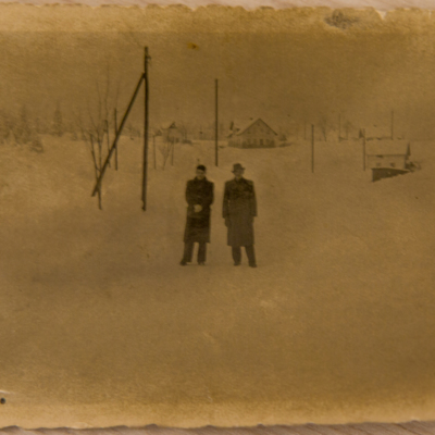 Two men standing in snow covered Srbska