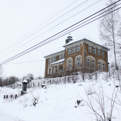 Old school building in winter