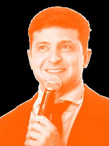 Headshot of Volodymyr Zelenky holding a microphone
