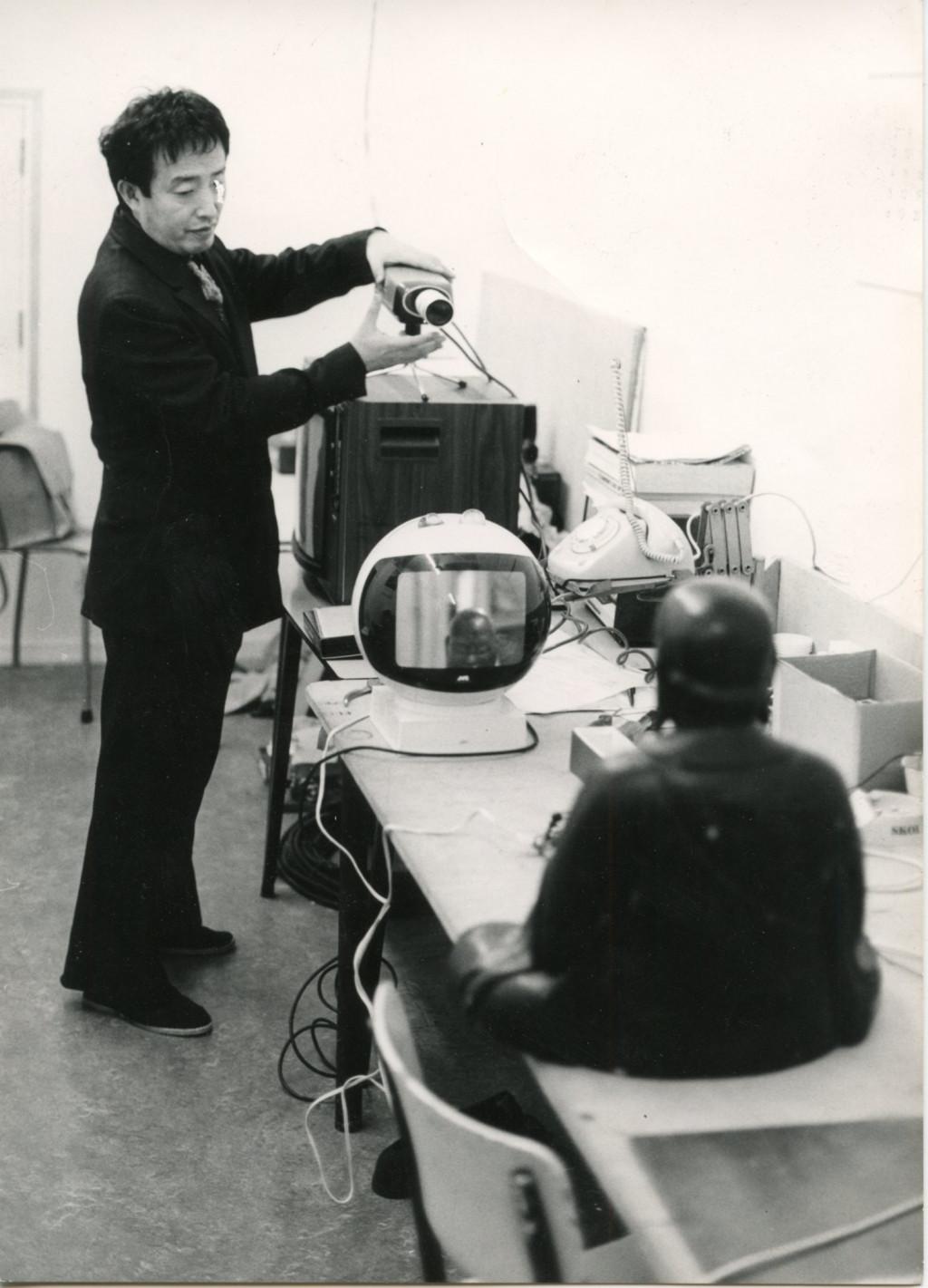 Nam June Paik installing TV-Buddha in the Stedelijk Museum. Photo: Rene Block