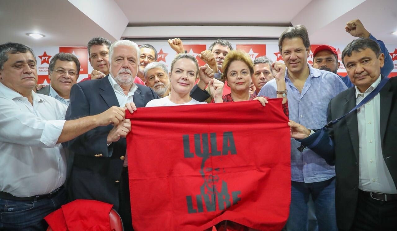 Brazilian PT militants holding a flag with the face of Lula asking for his freedom. SmartExpat