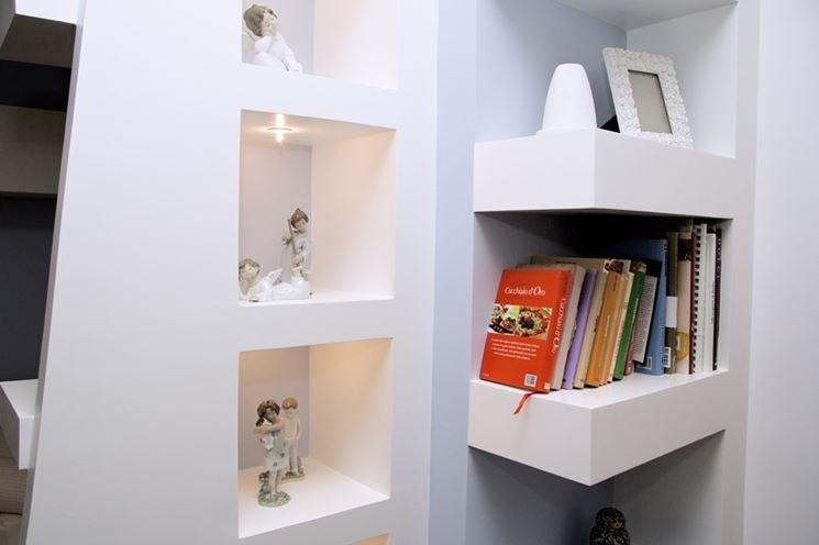 Parete attrezzata tv camino con mobili contenitori e parete libreria instapro - Parete divisoria in cartongesso ...