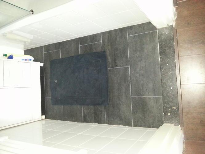Opnieuw betegelen badkamer en toilet - Werkspot