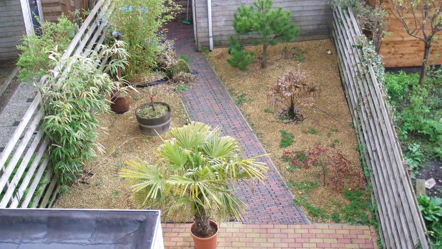 Grind verwijderen tuin aanbouw huis voorbeelden for Grind tuin
