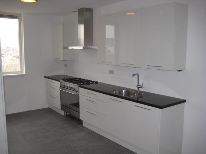Tegels keuken zetten werkspot - Keuken met cement tegels ...