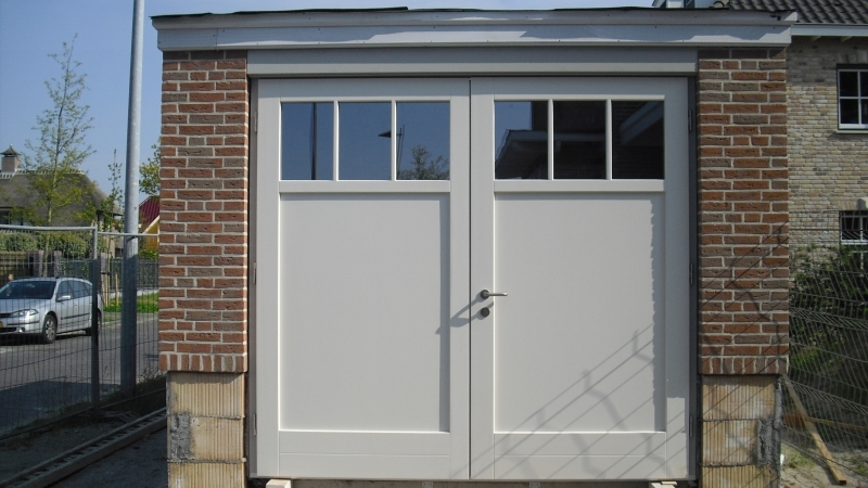 Geliefde roldeur garage vervangen door openslaande deuren - Werkspot #BT08